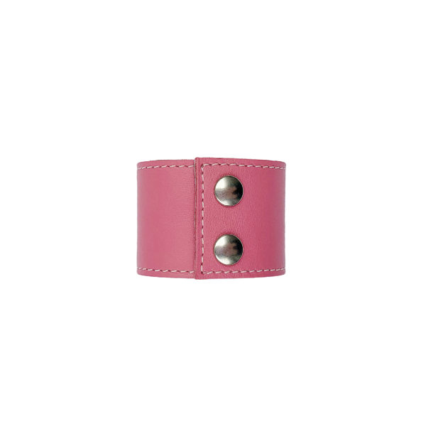Back of pink colored leather napkin ring with two silvercolored snap fasteners.
