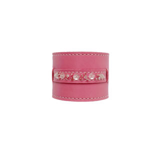 Pink colored leather napkin ring with beads.