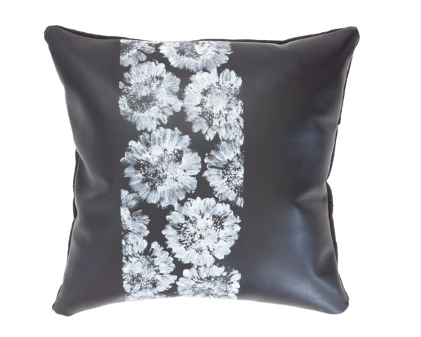 Black leather pillow with white Gerbera print.