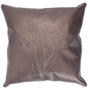 Brown leather pillow with stitched daffodil