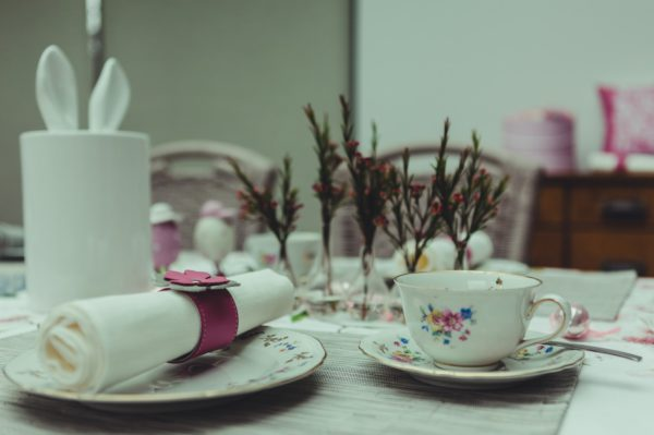 Decorated table with pink accents and pink leather napkin ring.