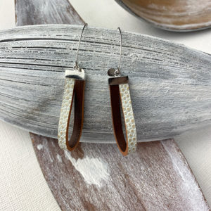 Sterling silver earrings with a dark brown and pebble printed leather loop