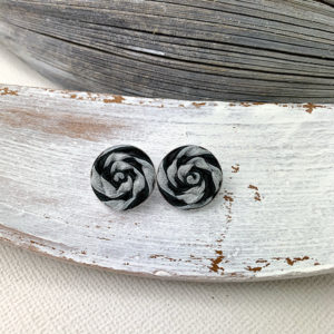 Sterling silver frame earrings with a black and white leather woven piece