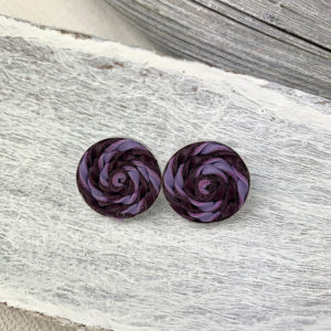 Sterling silver frame earrings with a dark purple and lavender leather woven piece