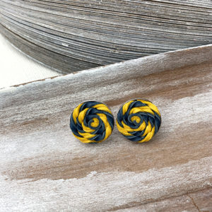 Sterling silver frame earrings with a yellow and dark blue leather woven piece