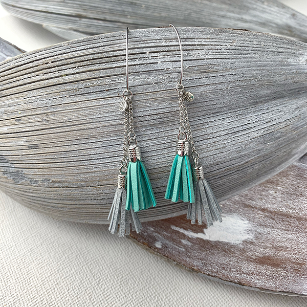 Sterling silver earrings with mint and silver leather tassels and round logo tag