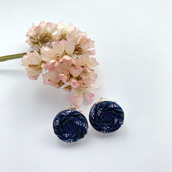 Pink flower and blue leather disk earrings