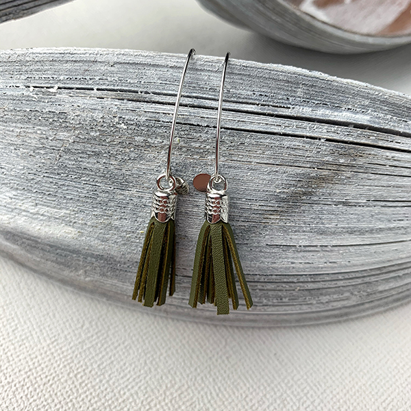 Sterling silver earrings with moss green leather tassels and round logo tag
