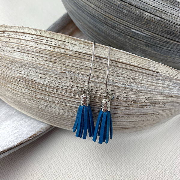 Sterling silver earrings with serenity leather tassels and round logo tag
