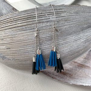Sterling silver earrings with serenity and black leather tassels and round logo tag