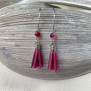 Sterling silver earrings with wine pink leather tassels, round semi-precious beads and round logo tag