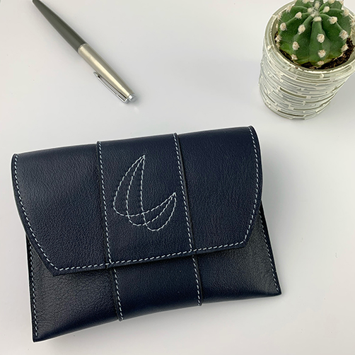 leather pouch in night blue leather with stitched decoration