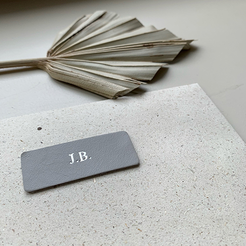 Silver Foil initials on leather tag envelope